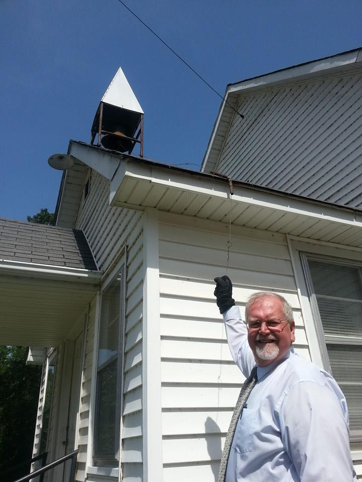 Pastor Dale Grubaugh rings the Smyrna Church bell every Sunday morning. Photo by Phillip Shuford.